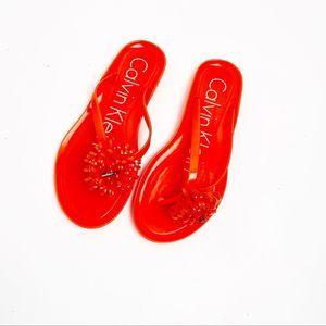 Calvin Klein Orange Floral Flip Flops
